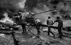 Czech citizens attack a Soviet tank in Prague - August 1968 Marie Curie, War Photography, Street Photography, Prague Spring, Warsaw Pact, Photographer Portfolio, First Photograph, Magnum Photos, Steve Jobs
