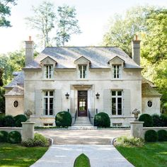 Stanley Dixon & Betty Burgess - Gorgeous French stone home exterior with gray shingle roof. French Chateau, French, home exterior, Atlanta Homes & Lifestyles