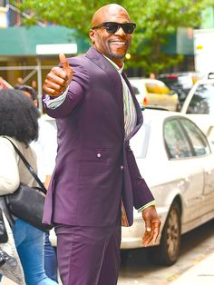 Star Tracks: Wednesday, October 22, 2014   PURPLE HAZE   He approves! Terry Crews gives a joyful thumbs-up outside of The View studios on Tuesday in New York City.