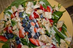 Strawberries, blueberries, walnuts, and grilled chicken drizzled with poppy-seed dressing and piled high upon a bed of spinach