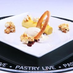 Chef Ami Dand's dessert from the 2012 Signature Plated Dessert competition, comprised of a caramelized corn custard, lemon ice cream and blackberry pearls. She too will be returning this year to compete once more! #pastrylive #pastryart #pastrychef #caramel #icecream #caramelcorn #delicious #yum #dessert #desserts #chefcompetition #plateddessert .