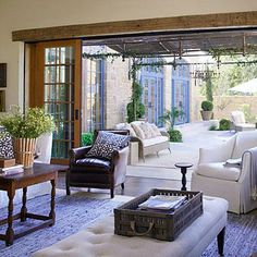Play Up the Views | At our Texas Idea House, we kept windows and sliding doors free of draperies to connect the indoors and out. | SouthernLiving.com