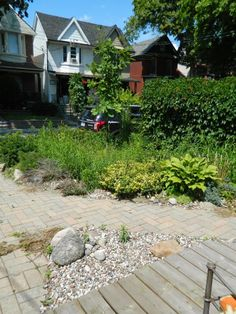 Leslieville front yard garden cleanup before by Paul Jung Gardening Services Toronto.   This typical small city front garden was completely infested with quack grass, which I dug out by hand.The end result? In the words of the client, the front yard isn't the embarrassment of the neighbourhood!