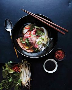 When the steaming broth is ladled into the bowl, the eye of round cooks and the onion and scallions lose their raw edge. The broth can be made up to one month ahead; remove the brisket and let the broth cool to room temperature before freezing. Wrap the brisket tightly in plastic, store it in a resealable freezer bag, and freeze it; thaw completely in the refrigerator before slicing.