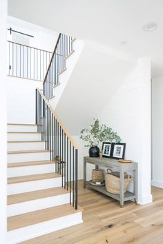 A Bright and Open New Construction by Ashley Clark of Shop sKout Entry Stairs, Staircase Railings, House Stairs, Wood Railing, Banisters, Staircases, Railing Design, Staircase Design, Modern Staircase