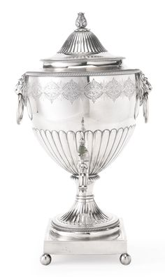 A George III Silver Tea Urn, Peter, Ann and William Bateman, London, 1804 vase form on square pedestal base on ball feet, the body engraved with band of flowers and leaves, molded and corded borders, lion head ring handles, domed cover and bud finial