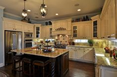 Love everything but the white cabinets.