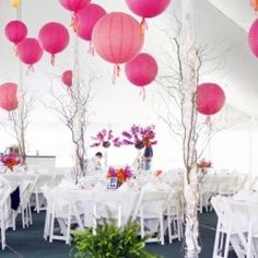 If you're looking to save money on wedding decor, use paper lanterns. They add so much beauty to a wedding space. (Image via Love Your Way)
