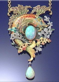 ENAMELLED GOLD, OPAL AND DIAMOND PENDANT, RAOUL-DIAZ WAGNER, CIRCA 1903 Designed as a leaping fish encircling an oval cabochon opal, with pliqué-à-jour enamel fins and circular-cut diamond set sea spray, to a curb link chain, one diamond deficient, length approximately 510mm, French assay marks and makers marks.