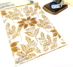 Christmas Arrangements Collection - Poinsettia and Holly Folder.  Apply ink to the folder with a rubber brayer (we used silver shimmer paper and Luminous Gold ink pad)