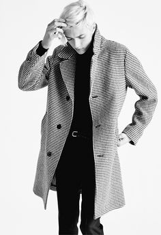 MEN'S AW15 LOOK 2   Black and white houndstooth full length balmacaan. Black classic cashmere turtle neck. Black mohair twill mélange tailored frogmouth pocket 18cm tailored sport pants. Tubular woven leather belt with vintage palladium buckle. Black burnished calfskin Philip vintage.
