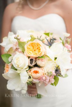 White, peach, and pink bridal bouquet for wedding photography.