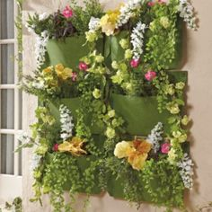 Vertical Living Wall Planter - made from recycled pladtic bottles.  Use indoors or outdoors  Military-grade moisture reservoir protects walls,