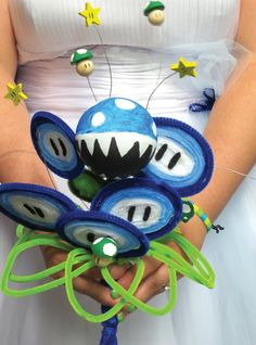 Laura Dickey Walker's homemade wedding bouquet was inspired by the Mario Galaxy and Super Mario Brothers video games. (JANAE FRANCIS/Standard-Examiner)