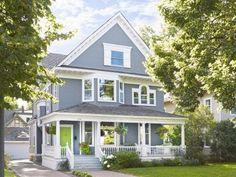 """Kathy Spraitz and Mike Swanson bought their 1899 home in 1999, but it was the one element that really caught their eye. """"We bought this porch, and the house came with it. It's still our favorite feature,"""" they say."""