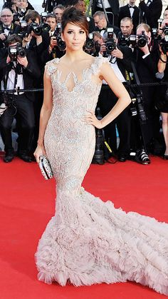 EVA LONGORIA IN MARCHESA, Cannes 2012 Longoria shut the red carpet down at the opening ceremony in this stunning Marchesa gown, complete with intricate embroidered details and a breath-taking tulle train.