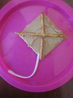 Alphabet Snacks: K is for kite graham cracker frosting pretzels and cheese