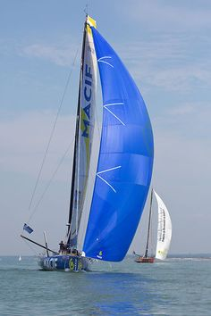 The IMOCA 60 yacht 'Macif' racing in a very light breeze during Cowes Week 2013.