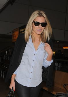 Mollie King in a classic look--dark denim skinnies, light blue button up, black blazer and ray bans