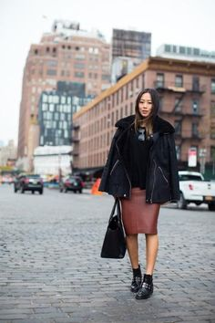 how to style your black booties - take notes from Aime Song and style them with a brown leather pencil skirt, black sweater, and cozy black winter coat