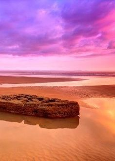 Located on the southern part of the Wales coastline in the village of Southerndown, Dunraven Bay offers stunning scenery including breathtaking cliff top walks, ruins, and much more. If you're feeling gutsy, you can climb on top of the rock formations for a truly spectacular view of the sunset.