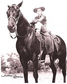 Johnny sitting on Chuck Connors horse Razor.