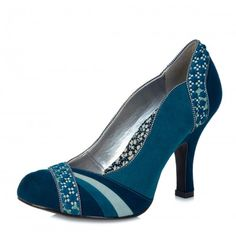 Ruby Shoo Heather women's court shoes are stylish and contemporary. In a soft faux suede upper, these fashion court shoes come in a vibrant teal colour with navy blue at the heel and toe.  Ruby Shoo Heather high heels also feature tonal stripes across the toe and the abstract patterned ribbon overlay panel creates a stylish finish. The subtle polka dot trim adds to the vintage inspired feel and the black rubber sole provides good grip. The round toe, slim high heel and curved sides help to…