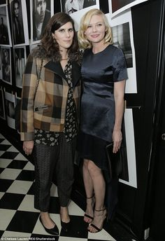 Star turn: Kirsten Dunst looked lovely in her shimmery frock alongside fashion designer La...