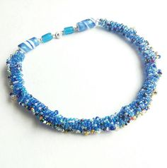 Check out this item in my Etsy shop https://www.etsy.com/listing/547161651/blue-beaded-necklace-unique-beadwork