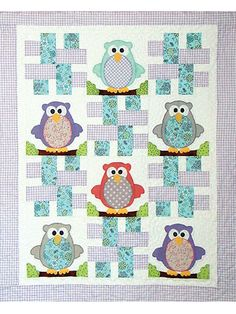 Make a darling owl quilt for your new child or grandchild!   This lovely pattern features 6 owls that can be customized for a boy or girl or made in gender-neutral colors. Easy strip-pieced blocks and simple fusible applique make this a fun and cute gift to give to an expectant mom as a baby shower gift.