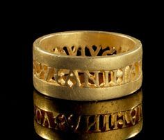 Gold ring with inscription in openwork (Ivy leaf) ANIMA DVLCIS VIVAS MECV (May you live with me sweet soul). Late Roman, 4th century AD.