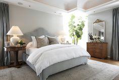 Light grey walls with dark grey curtains