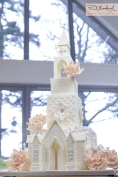 Learn to make this incredible Church Wedding Cake. Watch as paul shows us how to create such a stunning wedding cakeat www.designer-cakes.com