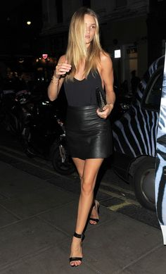 Leather skirt black flowy tank & black heels. Neon clutch?