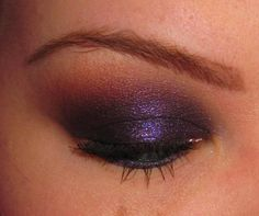 Omgosh! Love love love this blog. Her make up tutorials ROCK. This eye look is AMAZING!!! I need to start going my dramatic with my eyes. :)