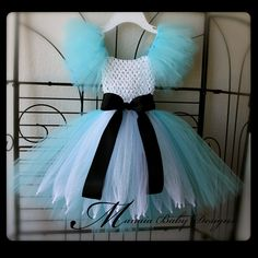 A fun Alice In Wonderland Inspired Tutu Dress. Available for $34.00, via Etsy.....I forsee my daughter in one for her Mad Hatter party....