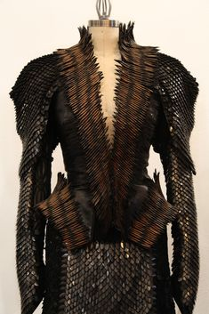 "A detail of the dress with leather ""scales"" worn by Charlize Theron in the film's climactic battle scene."