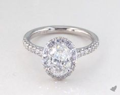 14k White Gold Presentation Solitaire (Four Prong) with 1.01 ct oval ring. Oval shaped halo is my 2nd favorite.