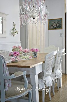 Vintage, shabby chic, romantic, elegant dining space. The chandelier is the perfect touch.