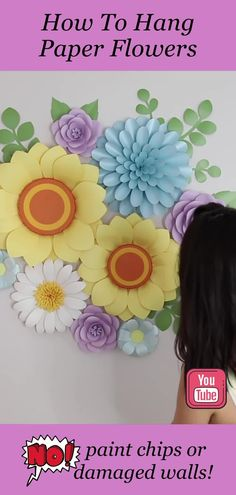 Learn How To Hang Paper Flowers on wall without damaging. Watch the step-by-step video tutorial, where I show you how to attach large paper flowers to the wall securely and without damaging the wall! I will show you all my techniques and tricks! Link to the full video tutorial attached to this pin. #paperflowertutorial #paperflowertemplates #giantpaperflowers Hanging Paper Flowers, Large Paper Flowers, Paper Flower Wall, Crepe Paper Flowers, Paper Dahlia, Paper Peonies, Paper Roses, Baby Shower Cakes For Boys, Baby Shower Decorations For Boys
