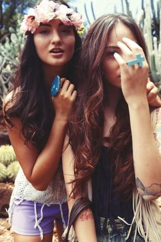 The elbow tattoo, the red one, the hair & turquoise ring. I <3 the girl on the right