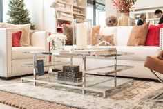 Glass and chrome coffee table - love the design with shelves on each end.