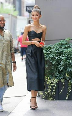 For a day out in New York City, Zendaya Coleman worked the jumpsuit trend in a black Solace London style, which featured a cutout bodice-like top and voluminous cropped trousers. Coleman kept the rest of her look minimal with an effortless top knot, simpl Mode Zendaya, Zendaya Style, Zendaya Outfits, Zendaya Coleman, Mode Inspiration, Looks Style, Mode Style, Fashion Outfits, Womens Fashion