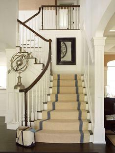 Beautiful stairs with white rails and dark banister.  Love the striped carpet runner!
