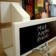 Pallet Kitchen Shelf with Chalkboard Paint Bulletin Board - ingenious! Store magazines, cook books, wine bottles, etc. could mount a towel rack, art clips, hooks for keys, kitchen utensils, etc. underneath it