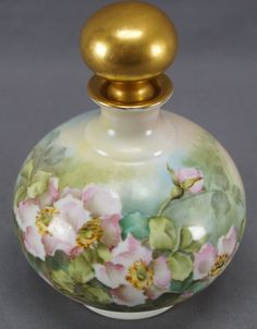 Very pretty porcelain dresser bottle with matching stopper. Nicely decorated with hand painted pink wild roses over a pink, yellow, green and blue background. With gold gilding along the rim of the neck and gold gilding to the stopper. | eBay!