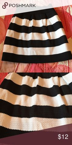 "Ponte Bell skirt size XS black and white ponte bell skirt...very small.  Waist is stretchy but 24"" and length is 16"" Skirts Mini"