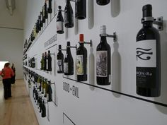awesome back bar idea, even it it was white shelves on white wall with the writing around them ie whiskey rum reds whites etc