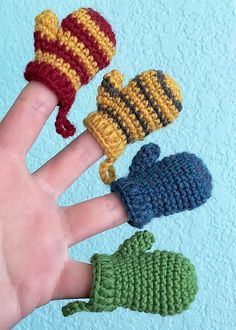 Mini Mittens Keychains, garlands, earrings, oh my! Make dozens of mini mittens to decorate both yourself and your home this holiday season. In the colors of a Hogwarts house or a favorite sports team, they make the perfect quick and easy handmade gift! Crochet Christmas Ornaments, Christmas Crochet Patterns, Holiday Crochet, Christmas Knitting, Christmas Crafts, Christmas Bunting, Minion Crochet Patterns, Minion Pattern, Crochet Crafts