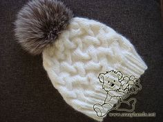 White cable knit hat for winter with silver fox fur pom pom